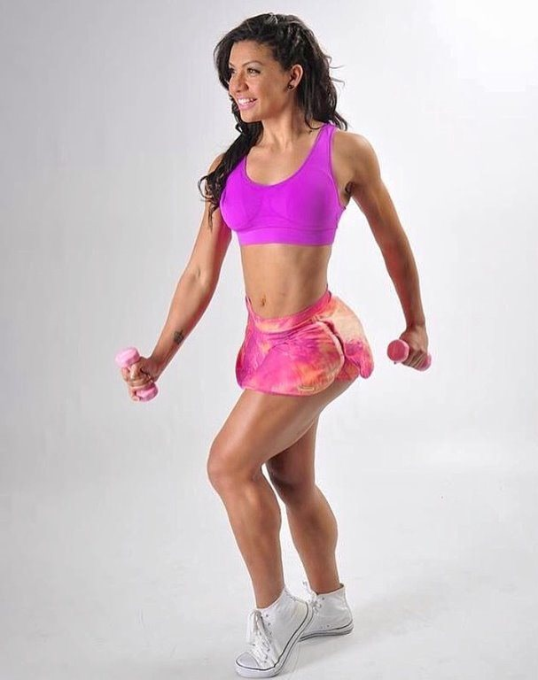 July Jardim posing in a photo shoot looking fit and lean