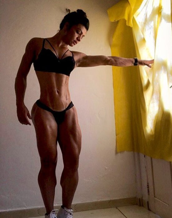 July Jardim showcasting her toned legs and midsection