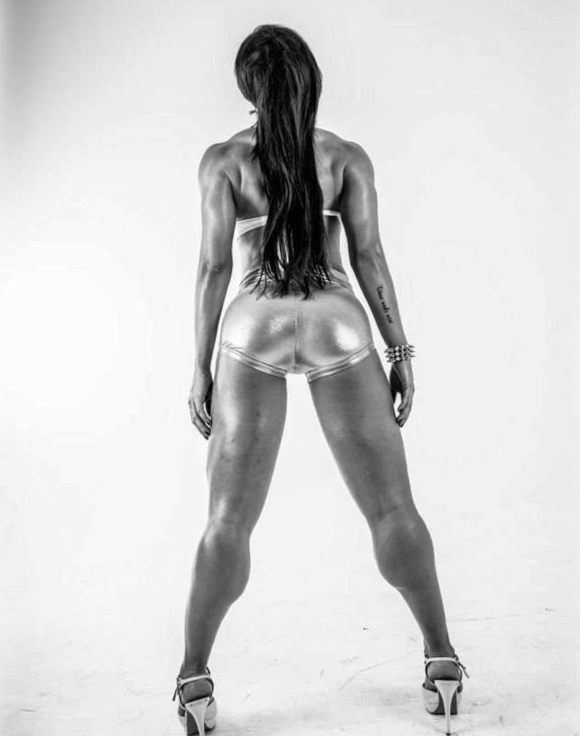July Jardim posing for the camera showing her glutes and legs