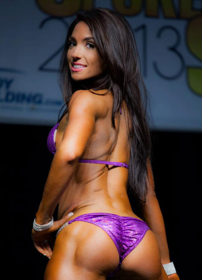 Karina Baymiller on stage wearing a bikini.