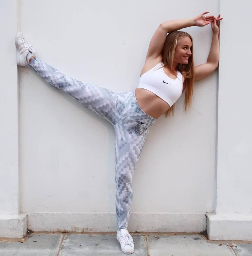 Kashira Whiteley stretching by the wall outside, looking fit and healthy