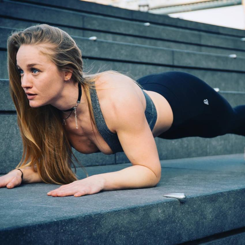 Kashira Whiteley doing planks outdoors