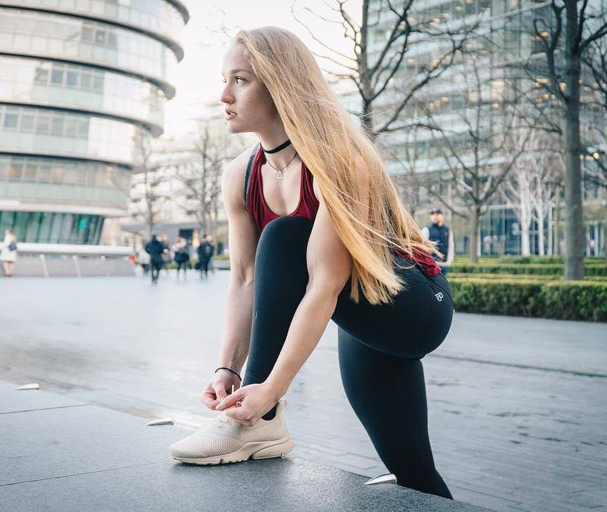 Kashira Whiteley tying her shoe outdoors looking fit and healthy