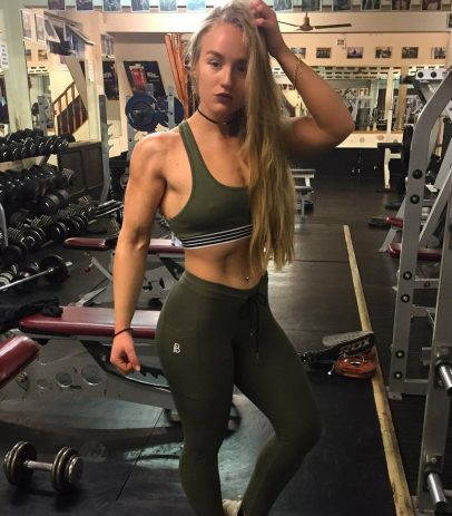 Kashira Whiteley posing in a gym in sports bra, looking fit and healthy