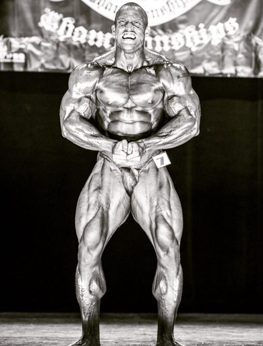 Kevin Jordan posing on the bodybuilding stage looking muscular and ripped