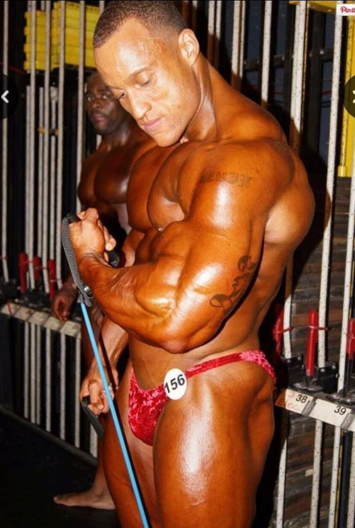 Kevin Jordan pumping up his muscles backstage before a bodybuilding contest