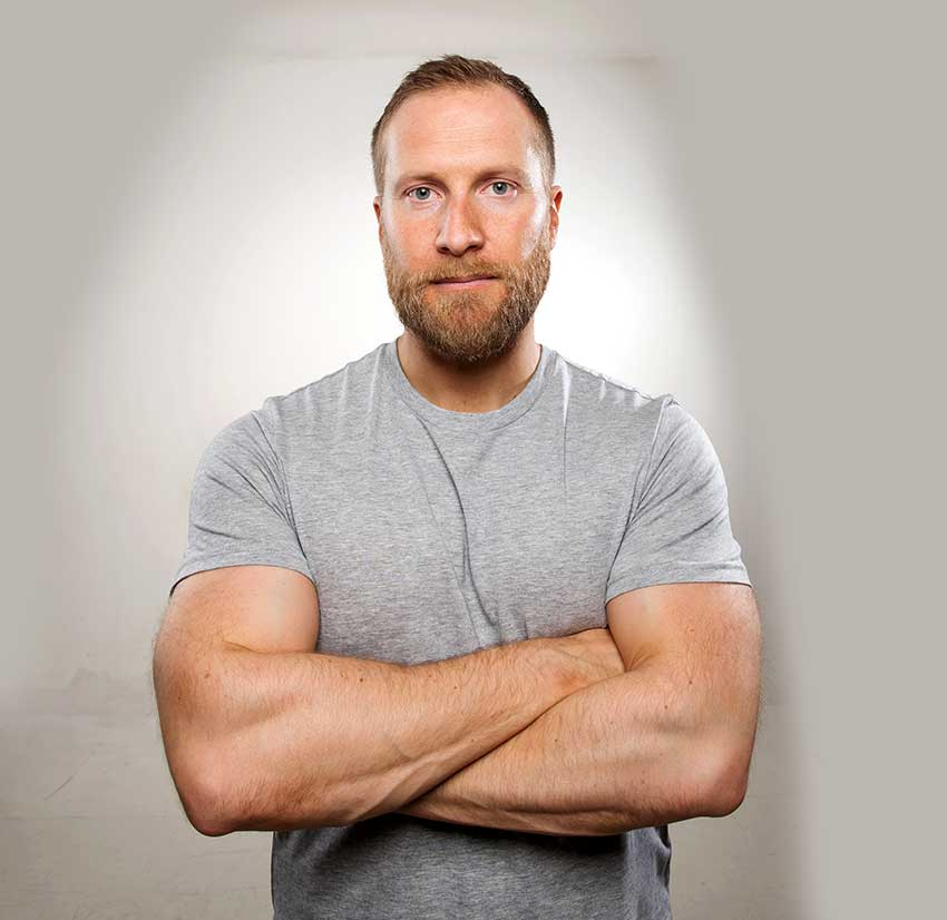 Lee Bell folding his arms looking muscular and healthy