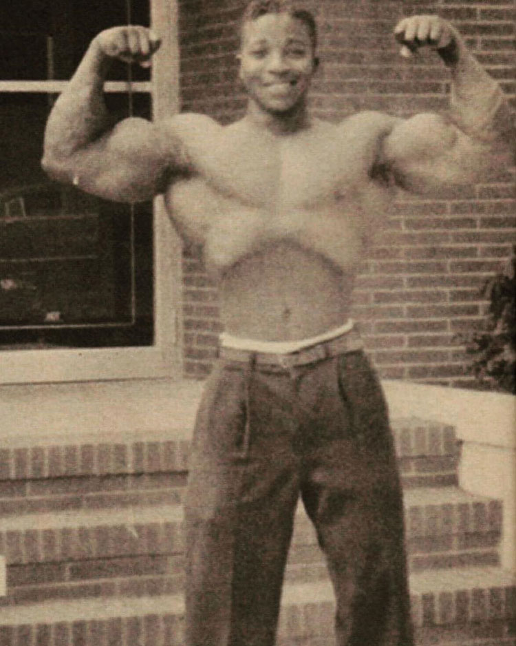 Leroy Colbert flexing his biceps.