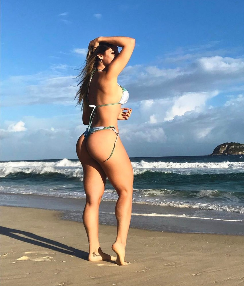 Mariana Castilho enjoying the view on the beach while showcasting her curvy physique