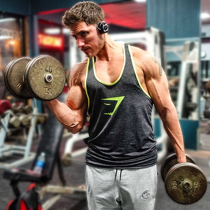 Matty Fusaro performing dumbbell bicep curls.