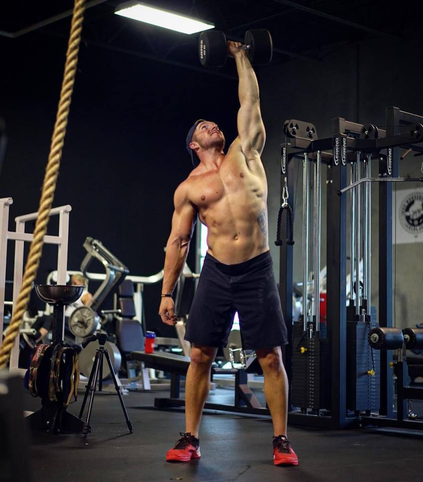 Nick Bare doing kettlebell training in a gym