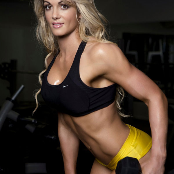 Raechelle Chase holding a dumbbell in a photo shoot.