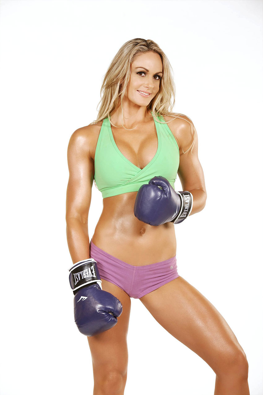 Raechelle Chase with boxing gloves in a photo shoot.