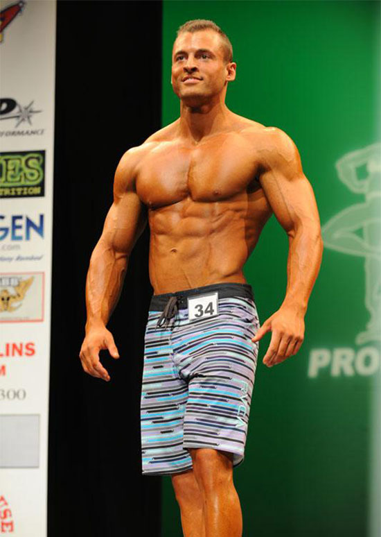 Ryan Hughes on the bodybuilding stage.