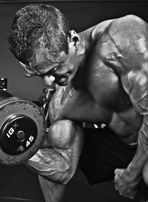 Ryan Hughes performing a dumbbell concentration curl.