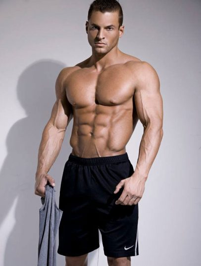 Ryan Hughes in a photo shoot showing off his shredded abs.