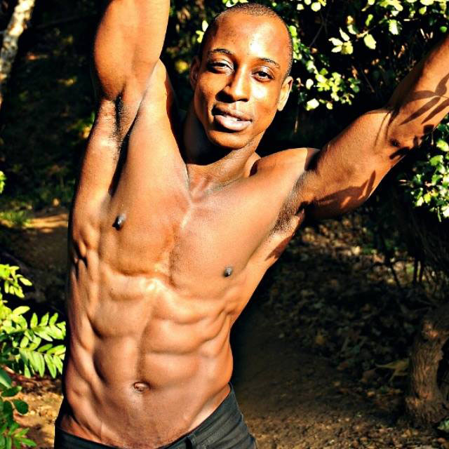 Shaka Smith showing off his ripped abs.