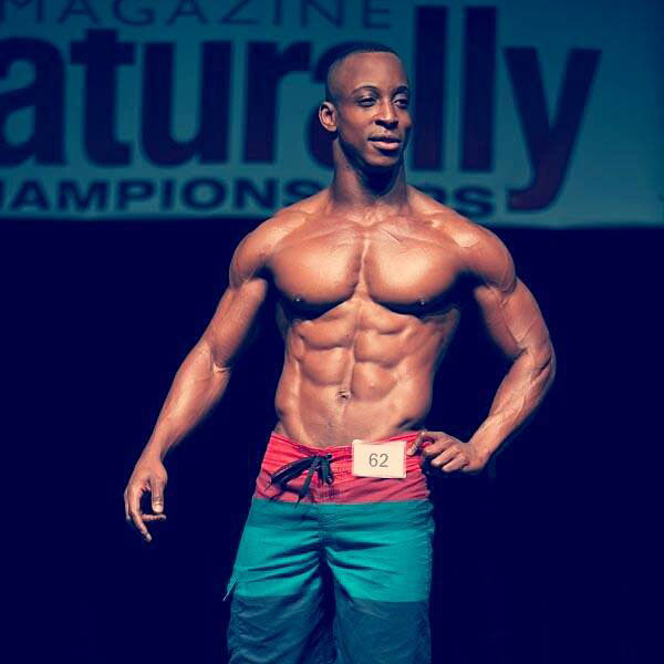 Shaka Smith on the bodybuilding stage.