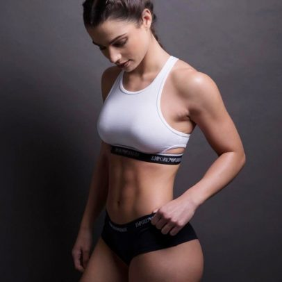 Sissy Mua posing in a photo shoot, looking lean and fit