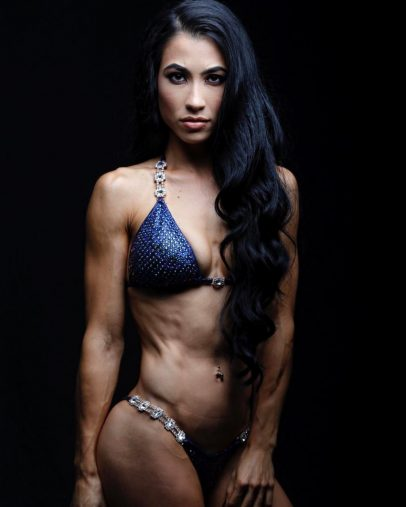 Stephanie Buttermore posing in a photo shoot looking extremely ripped