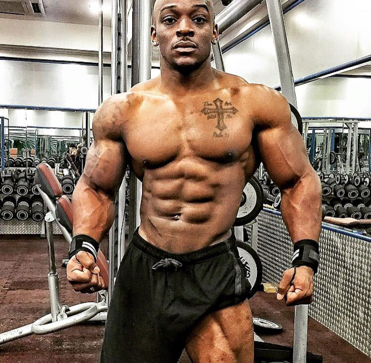 Tyrone Ogedegbe showing off his shredded physique in the gym.