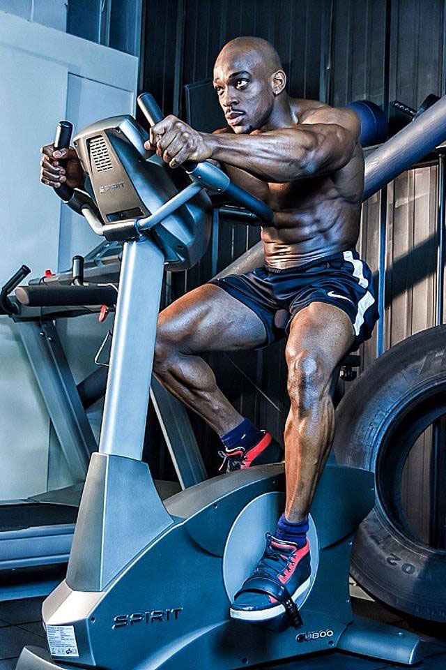 Tyrone Ogedegbe performing cardio on a stationary bike.
