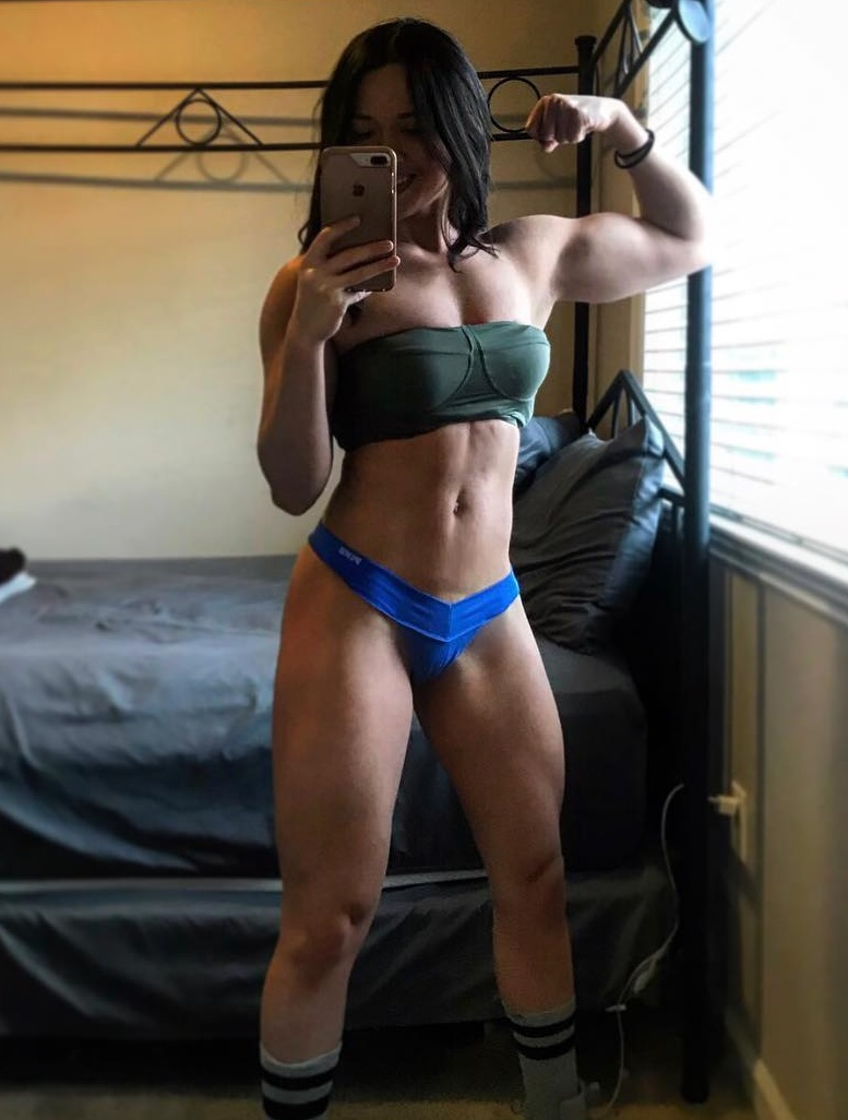 Alexis Mariah Avina taking a selfie of her flexed muscles looking toned