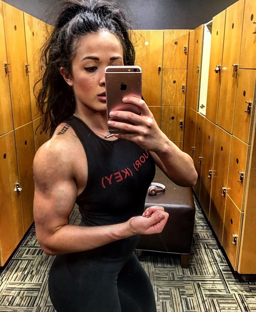 Alexis Mariah Avina taking a selfie of her muscular and ripped arms