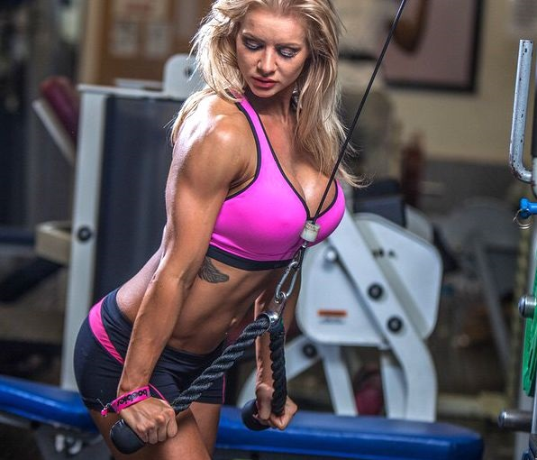 Charlene Borley doing triceps extensions looking toned and lean