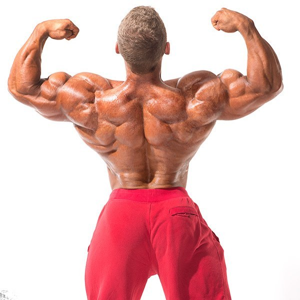 Cody Montgomery doing a back double biceps pose looking muscular and big