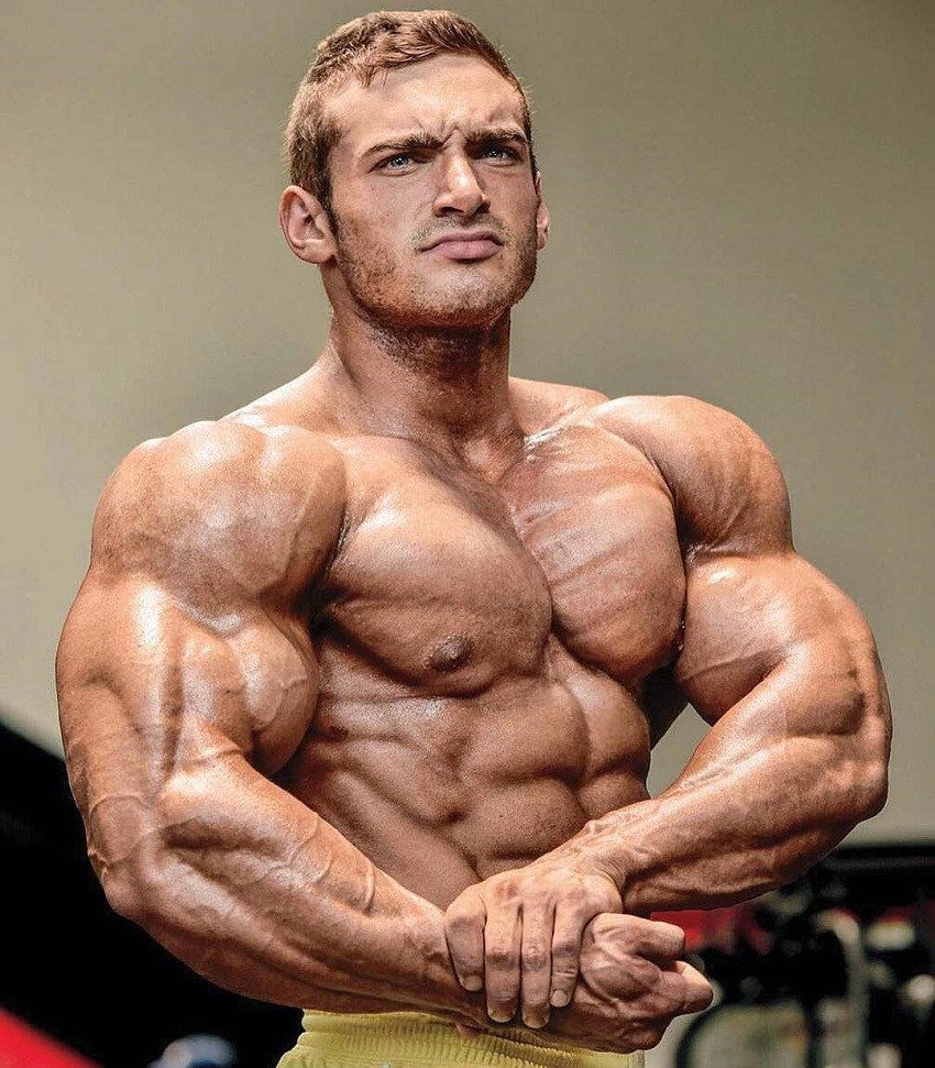 Cody Montgomery performing a side chest pose looking ripped and muscular