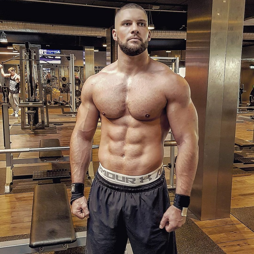 Florian Munteanu posing shirtless for a photo looking muscular and lean