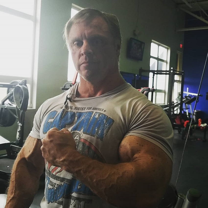 John Meadows showcasing his huge shirt-popping arms
