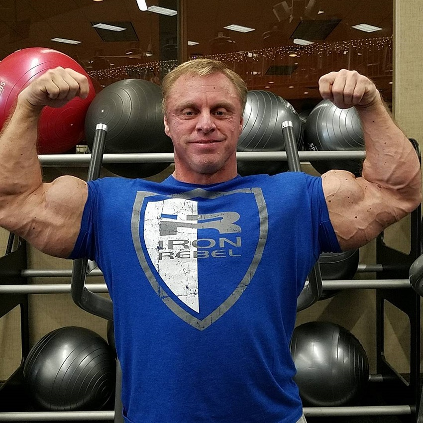 John Meadows flexing his biceps for a photo