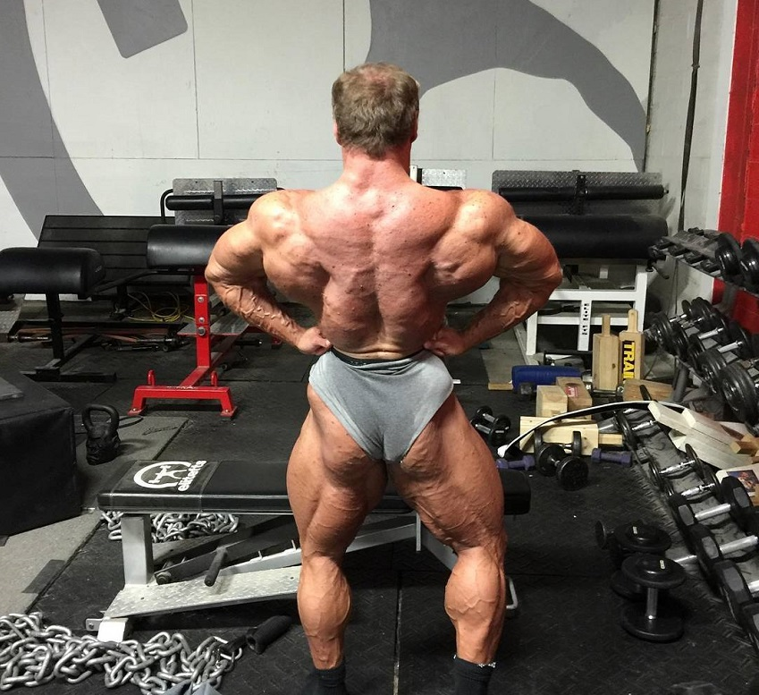 John Meadows showcasting his huge and wide lats for the photo