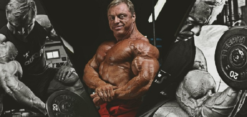 John Meadows doing a side chest pose looking big ripped and fit