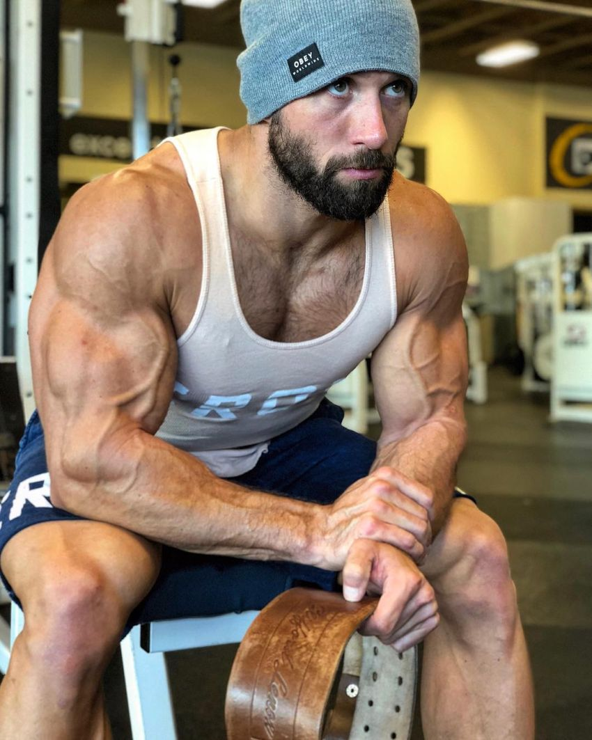 Julian Smith sitting on a bench looking big and vascular