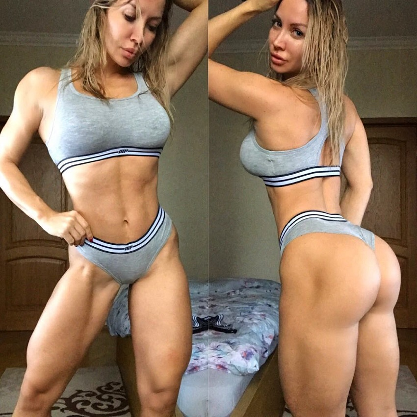 Kate Krasavina posing for a picture, showing off her curvy legs and glutes