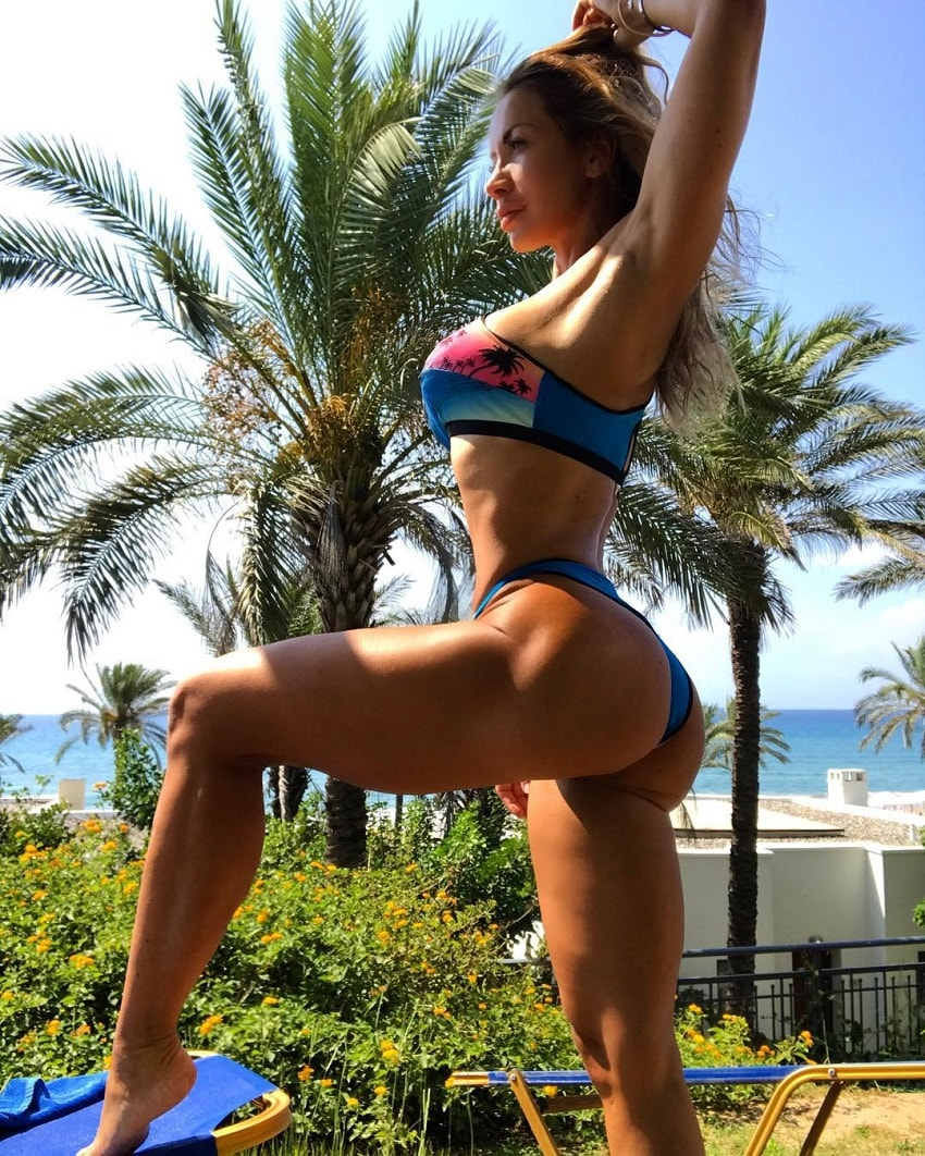 Kate Krasavina enjoying the sun showing off her tanned lean and fit physique