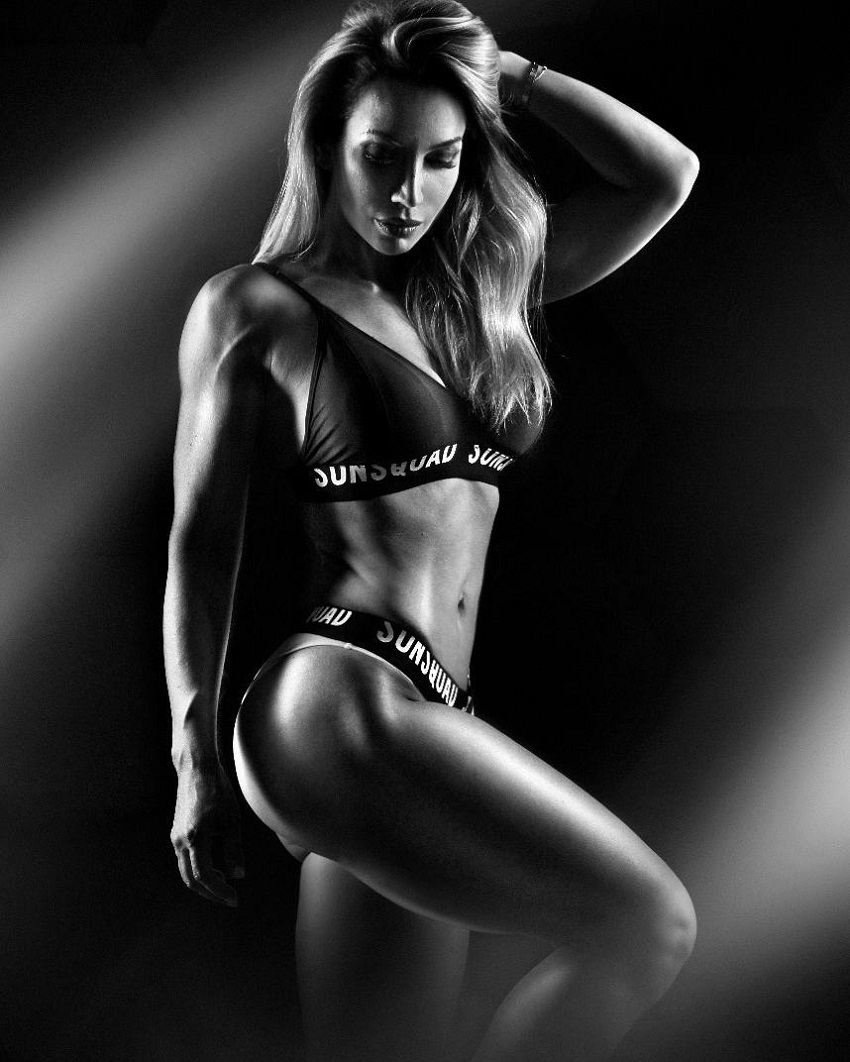 Kate Krasavina posing in a photo shoot showcasing her awesome physique