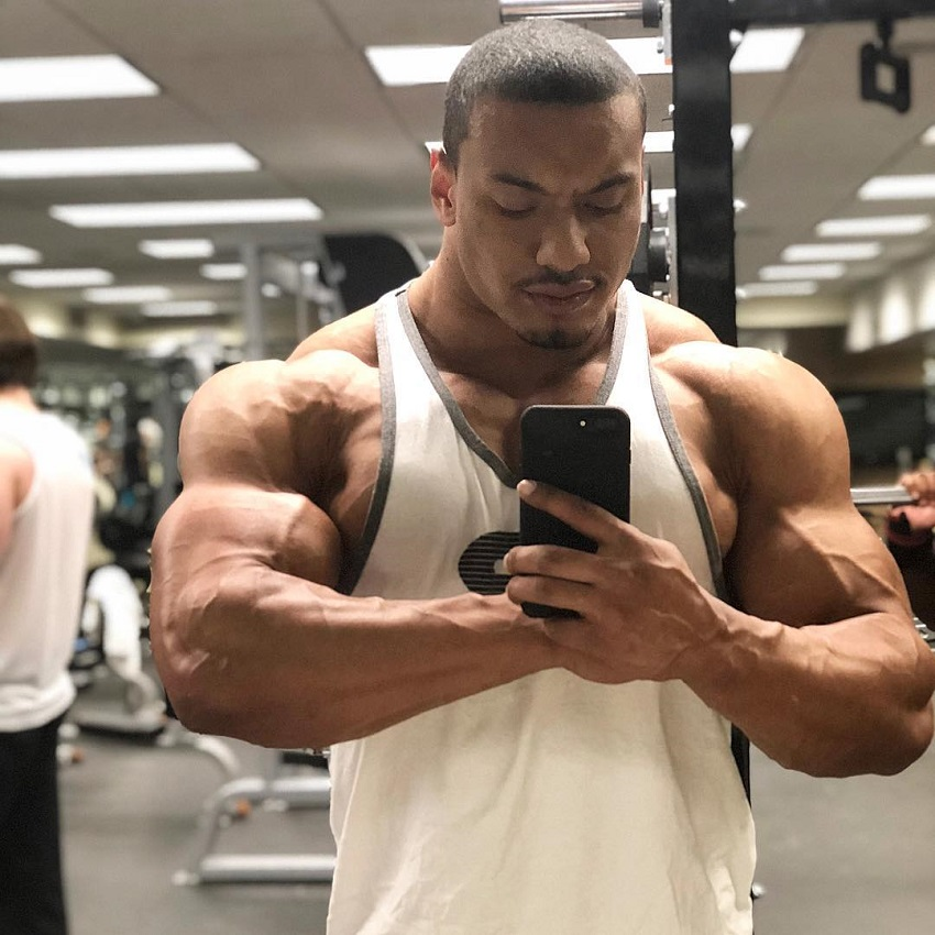 Larry Wheels taking a selfie of his muscular physique