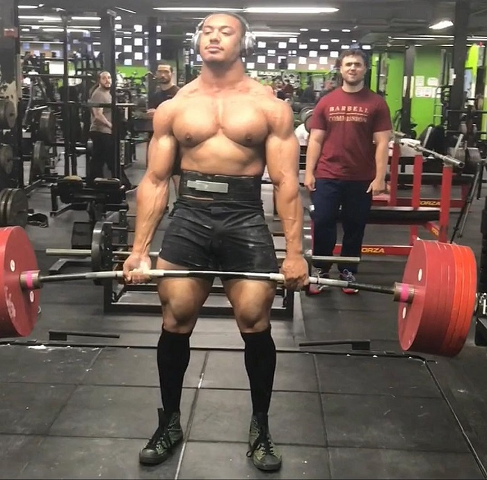 Larry Wheels lifting heavy deadlifts shirtless in the gym