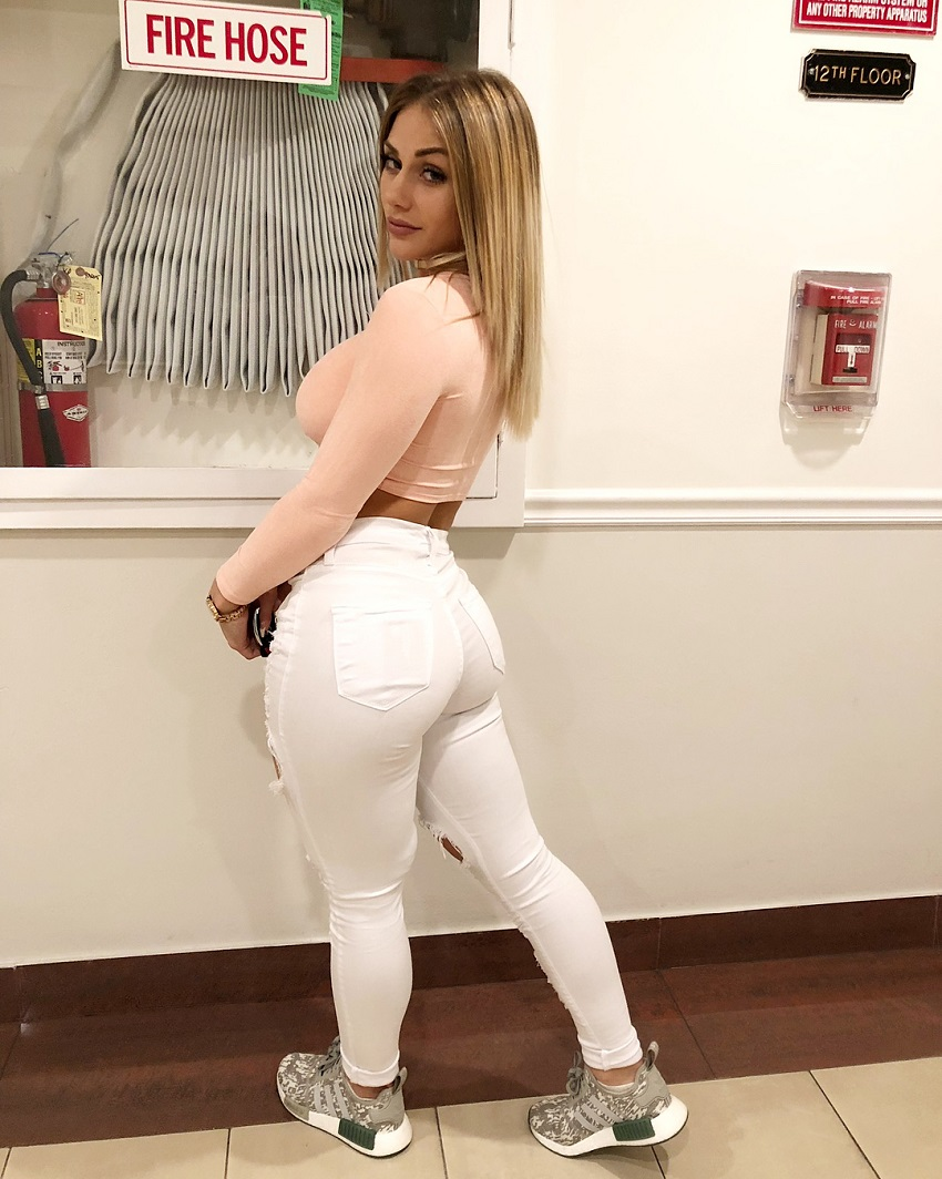Marine Smezz showcasing her incredible legs and glutes in white jeans