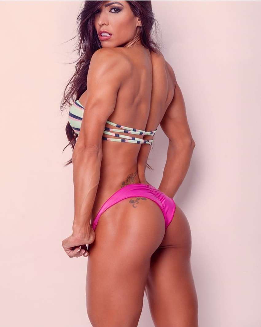 Muri Rodrigues psoing in a bikini showing off her lean backside