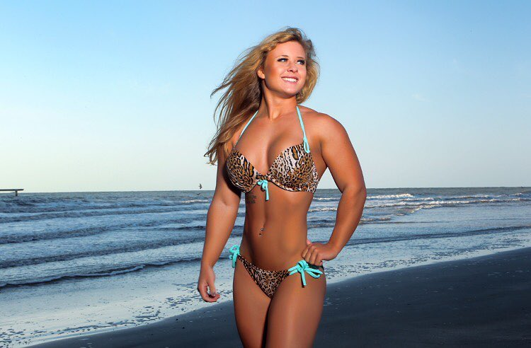 Shelby Dueitt standing by the beach and smiling while looking at the sky