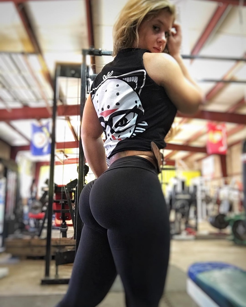 Shelby Dueitt showcasing her curvy legs and glutes in black yoga pants
