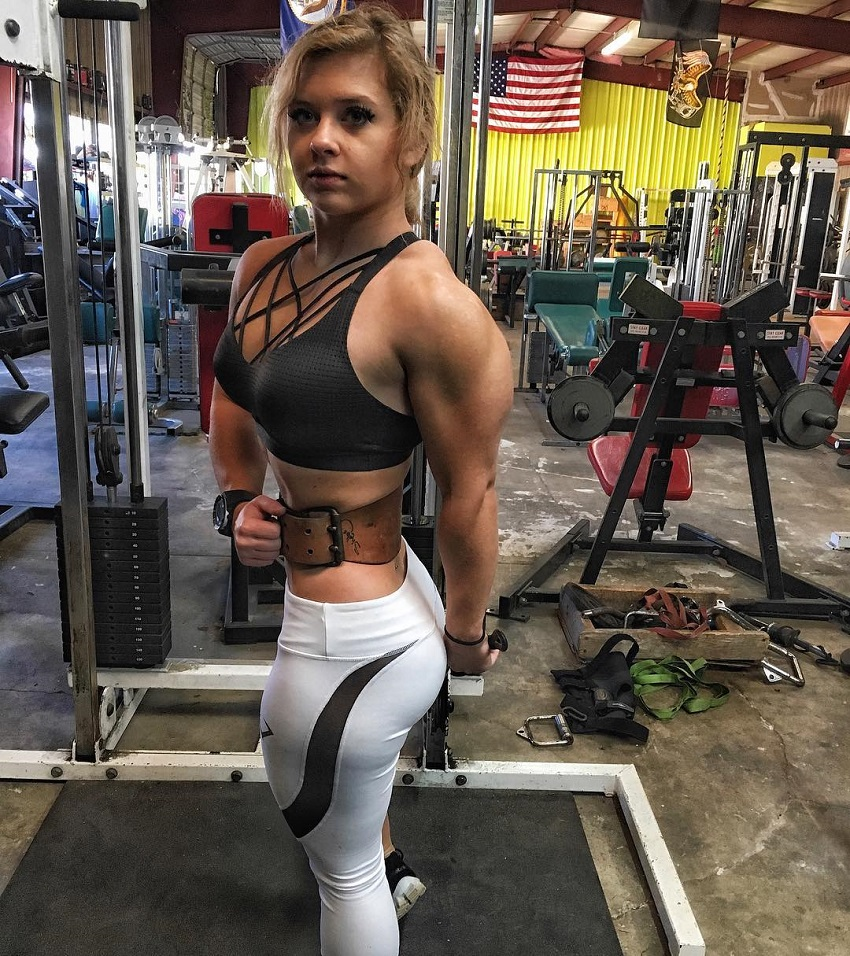 Shelby Dueitt flexing her lean and muscular arms in the gym