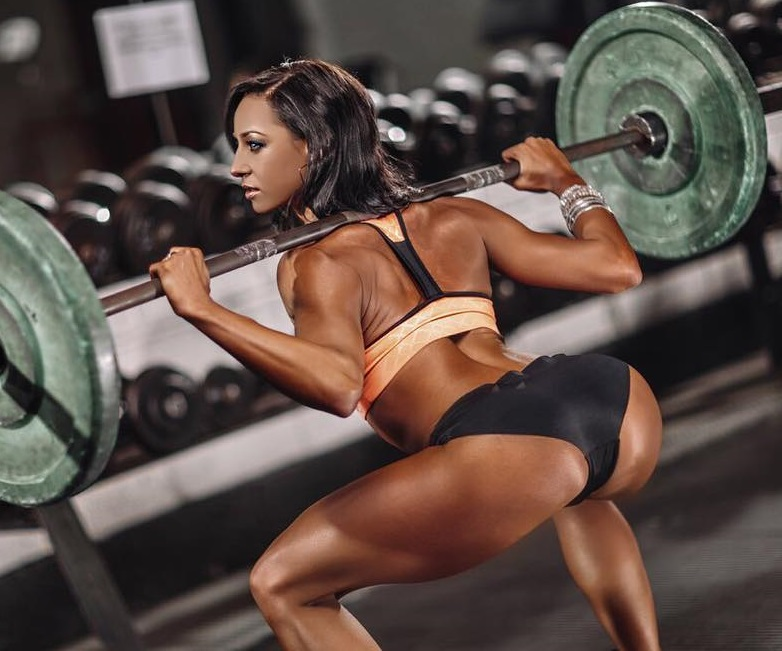 Amy Leigh-Quine doing deep barbell squats looking fit and curvy