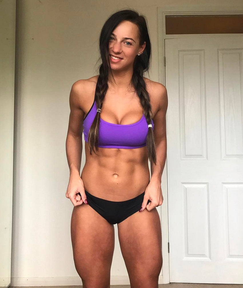 Amy Leigh-Quine posing for a photo showcasing her lean midsection