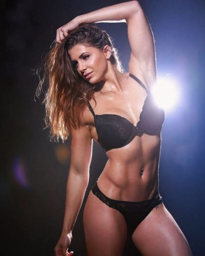 Andrina Santoro posing in a photo shoot in black bra and lingerie looking fit and lean